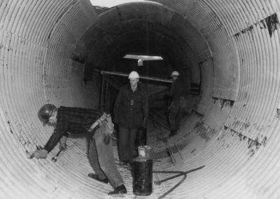 Blast Tunnel Construction, two men working inside the tunnel