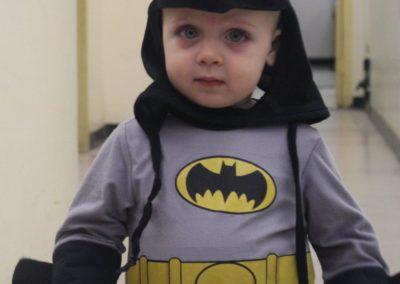 Child dressed as batman inside the bunker