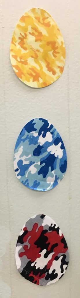 Yellow, blue and red camo easter eggs