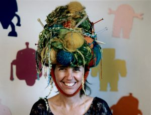 Greta Grip, artist, wearing her art as a hat