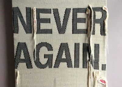 Never Again knitted artwork