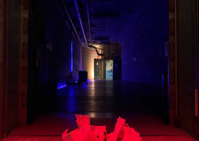 treat bowl lit with red lights in a dark hallway of the Bunker